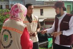 Koordinator Posko PPNI berkoordinasi dengan rombongan FIKES UNAS tentang pemberian Bantuan