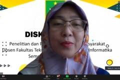 Dekan FTKI, Dr. Septi Andryana, S.Kom., MMSI. saat memberikan sambutannya dalam diskusi ilmiah