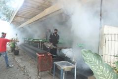 Petugas melakukan pengasapan fogging di area kantin Unas