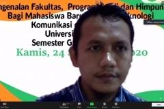 Ketua Program Studi Sistem Informasi, Dr. Agung Triayudi, S.Kom., M.Kom.  sedang menjelaskan paparannya