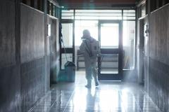 Penyemprotan desinfektan di depan ruang kelas