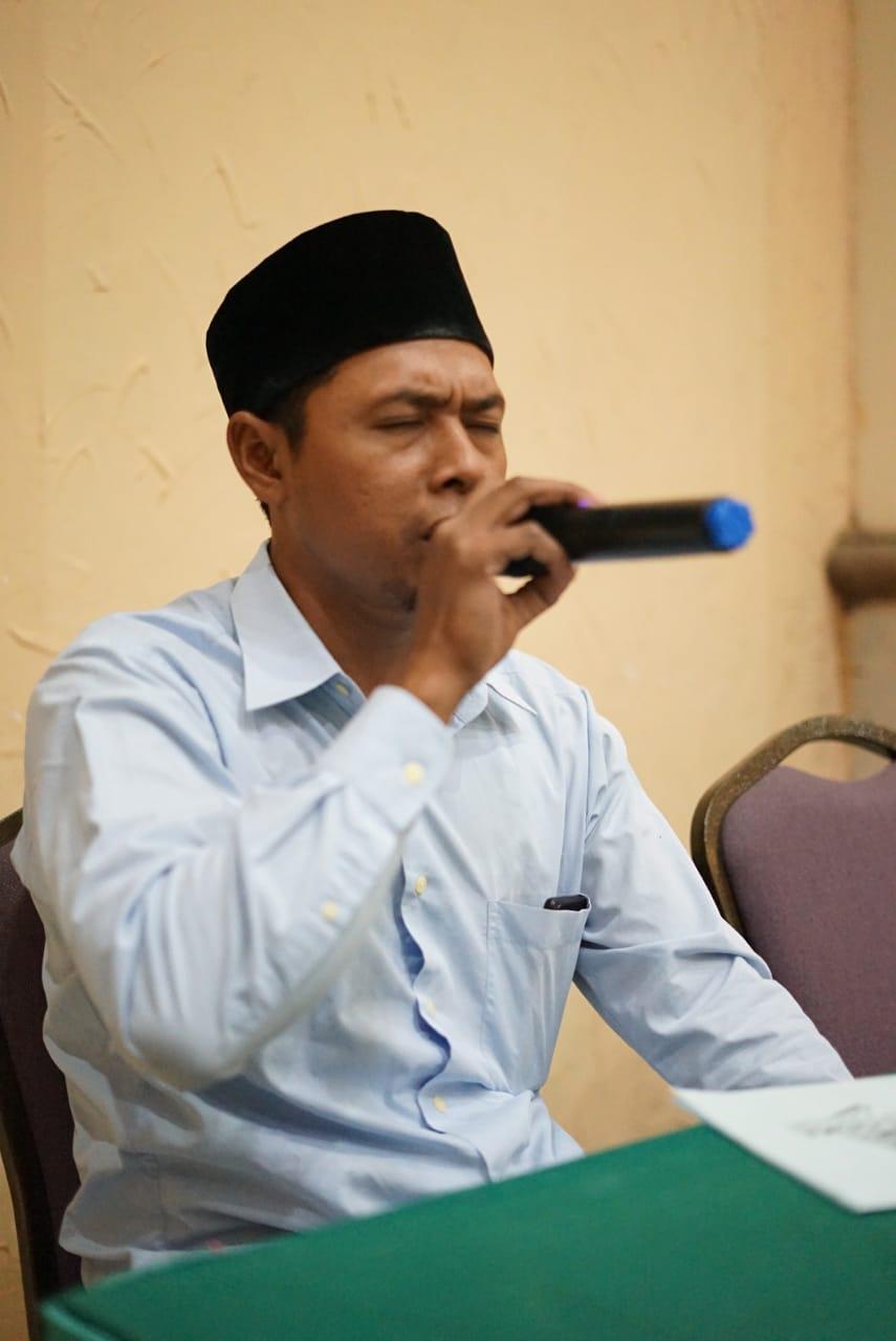 Pembacaan kitab suci Al-Quran oleh Dai