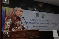 Ketua YMIK, Dr. Ramlan Siregar, M.Si. sedang memberikan sambutan dalam pembukaan sosialisasi