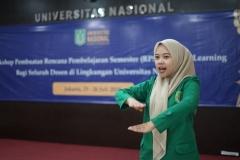Menyanyikan lagu Indonesia Raya & Mars UNAS